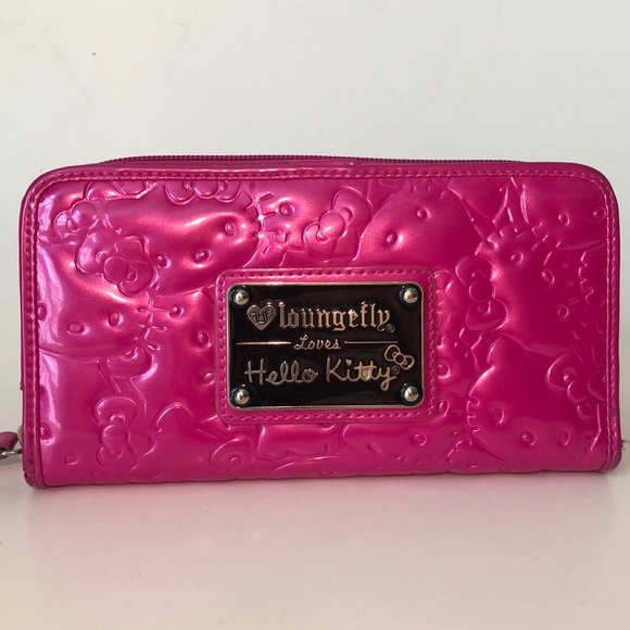 b19689a9d Loungefly Handbags - Loungefly loves Hello Kitty Pink Embossed Wallet